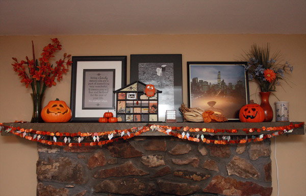 my altered halloween house is my favorite decoration for this season and the glittery pumpkin and boo garland is definitely a kid favorite especially